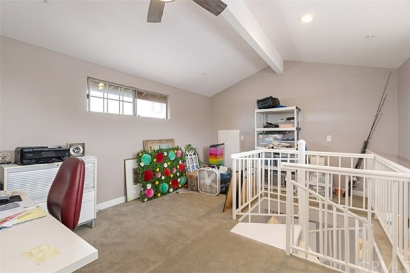 Large private loft/office/craft area above master, with even more storage in attic!