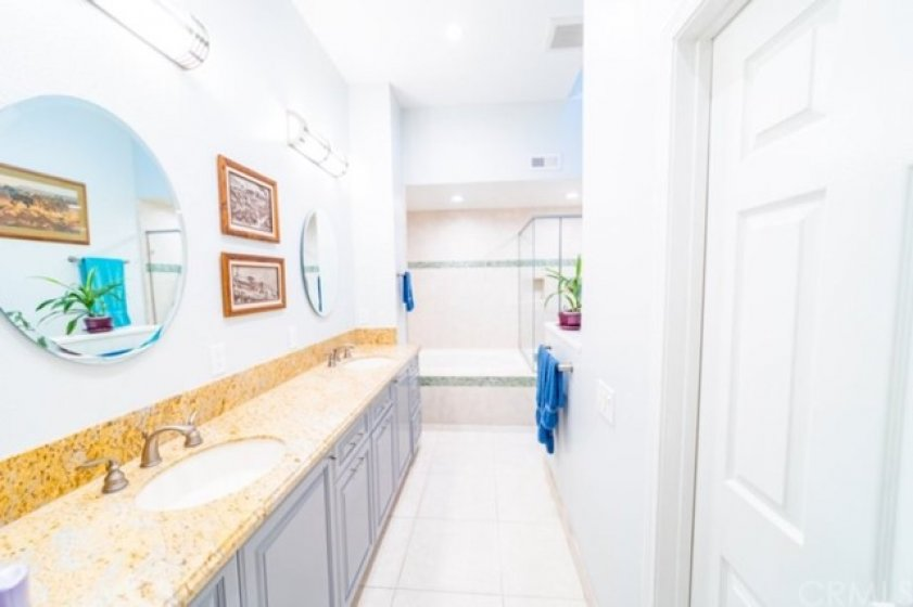 Master Bathroom with Glass Shower and Large Tub