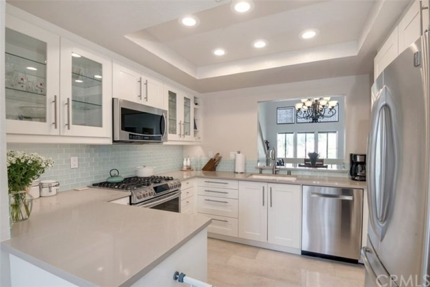 Smart, bright, functional, newly remodeled kitchen with recessed lighting.
