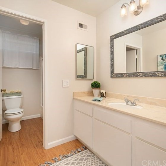The upstairs bathroom has lots of space and a bathtub