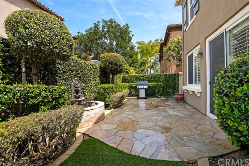 Note the stunning custom designed flagstone patio with fountain