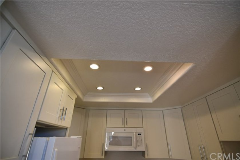 Not all kitchens have recessed lighting and crown molding. But yours does. Enjoy!! Lots of light and makes it easy to see all you need.