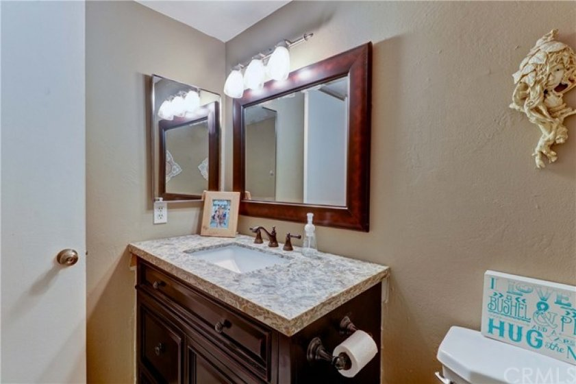 Main floor powder room is stylish and chic.