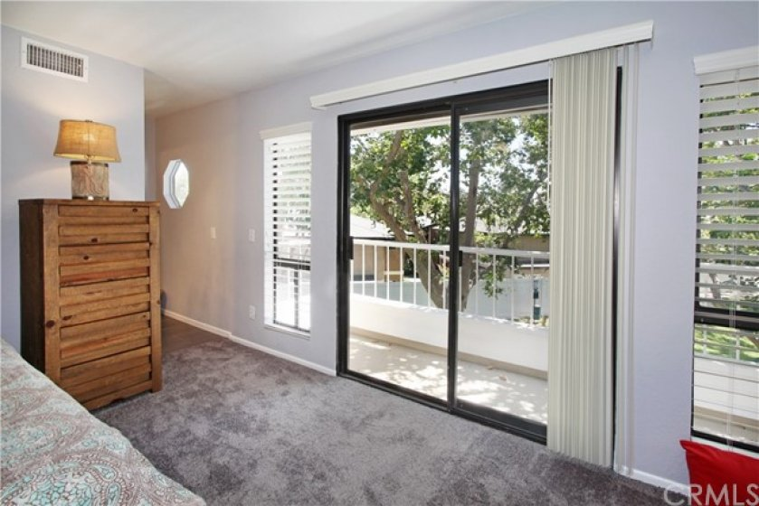 Master bedroom has direct access to private balcony