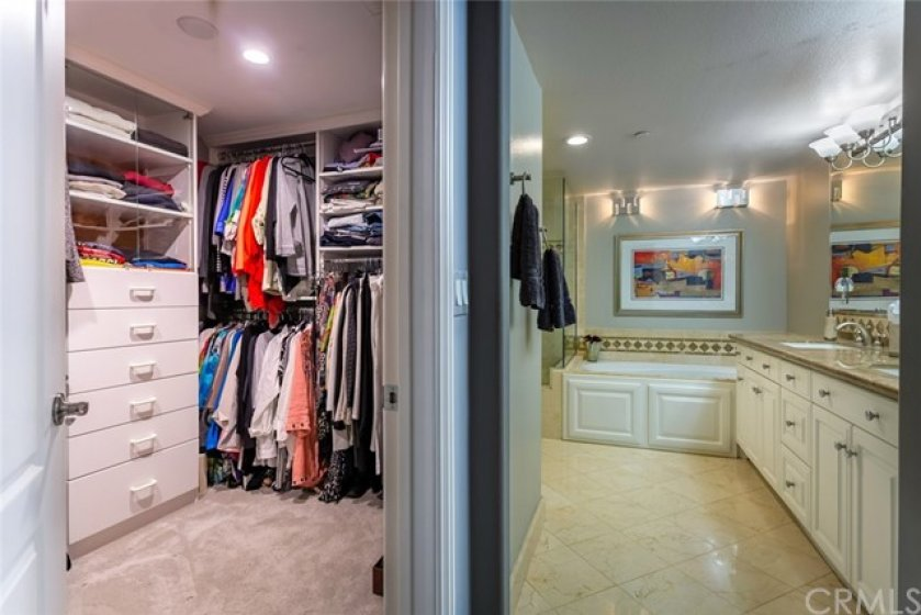 Walk In Closets with Custom Built In's and Master Bathroom