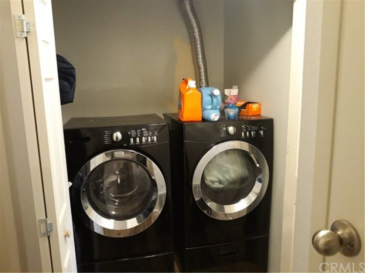Indoor laundry room with both gas and electric hook ups.