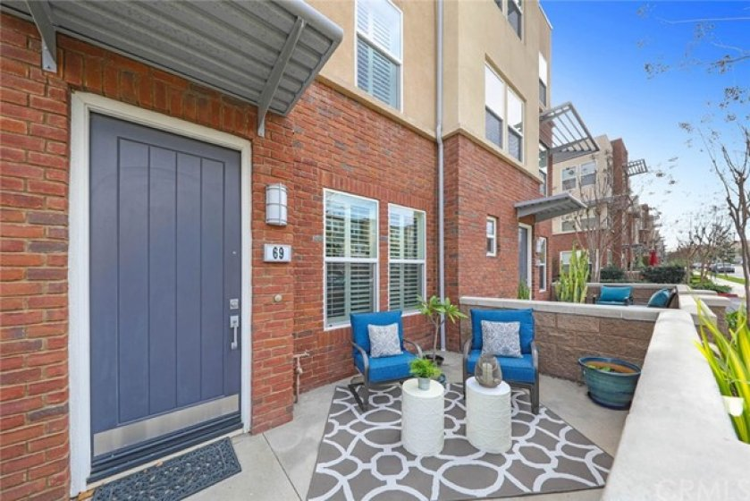 Spacious front patio to relax after work.