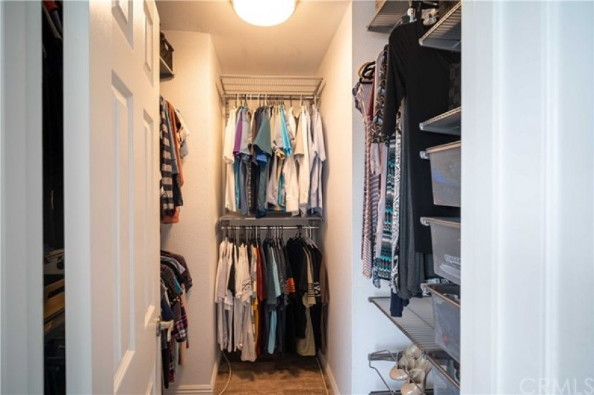 Walk-in master closet with tons of storage