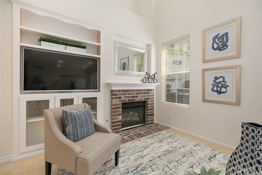 Cozy fireplace, and custom media center for your TV and equipment.  This is a wonderful seating area where you can enjoy movie night with friends and family.