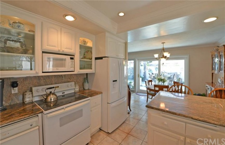 Kitchen, Granite counters and glass door cabinets for display.