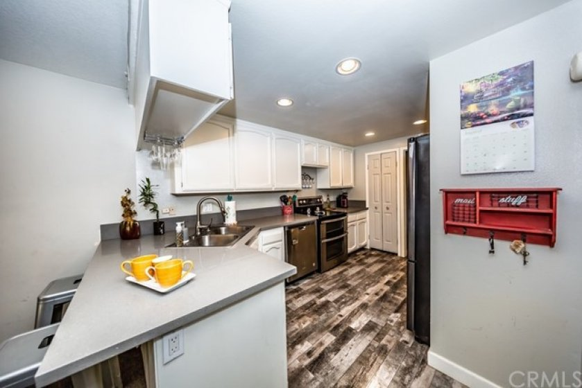 Beautiful kitchen with recessed lighting, plenty of cabinets, newer counter-tops and a pantry.