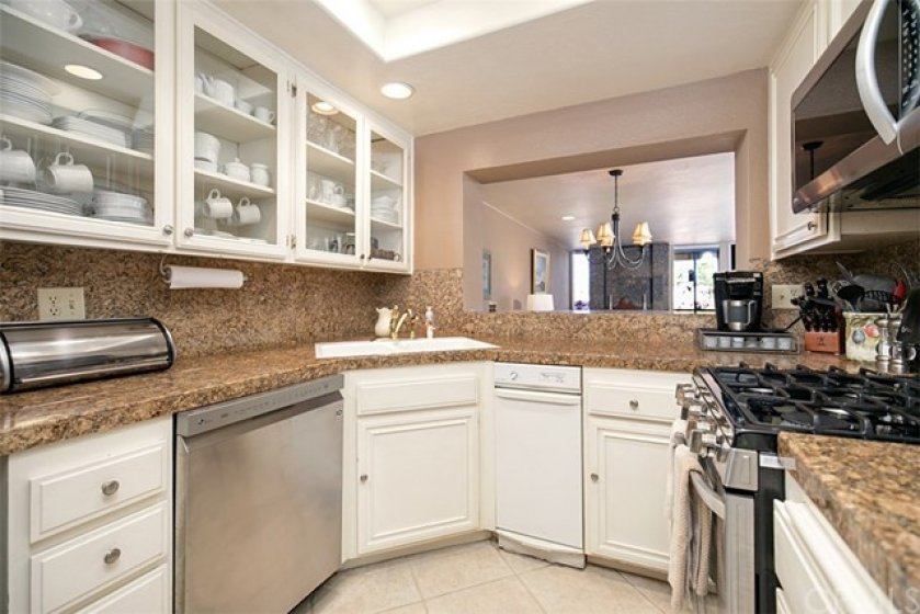 Granite counters and recessed lighting in the kitchen
