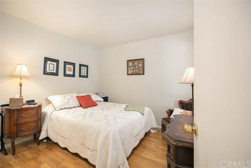 Sercondary bedroom with laminate flooring