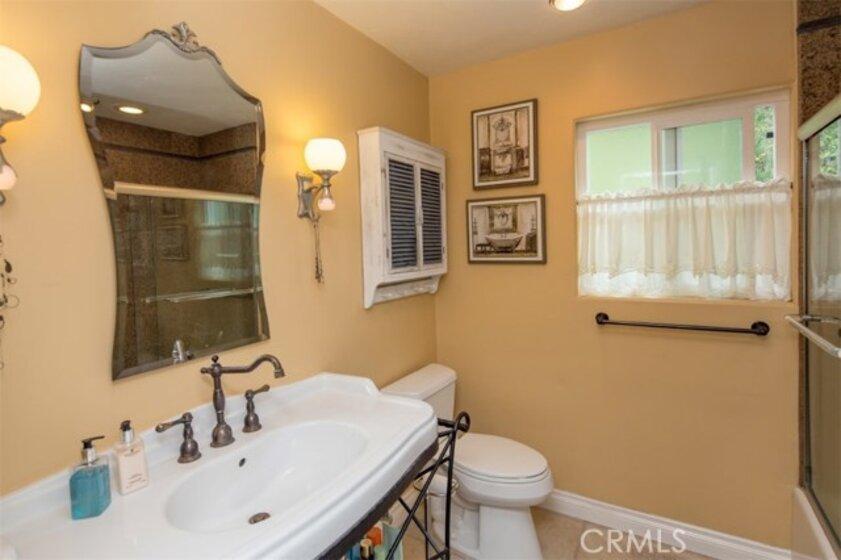 Remodeled bathroom with custom sink.