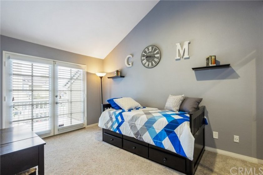 This bedroom has a high vaulted ceiling and plush carpet for warmth and comofort. The double french doors lead to a large pri.vate balcony. Beautiful!