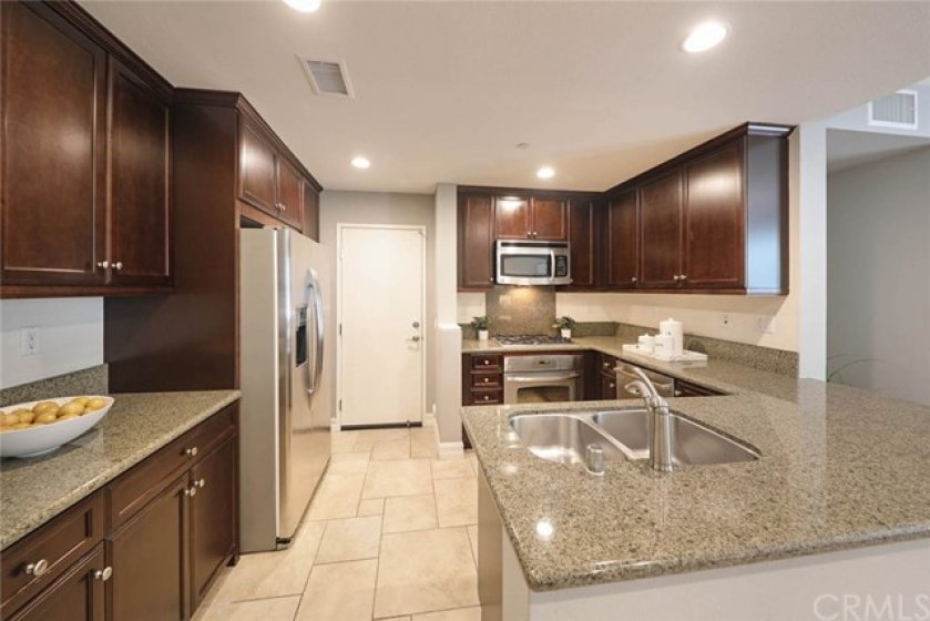 Modern style, just the way you like your dream kitchen to be includes stainless steel appliance and granite countertops.
