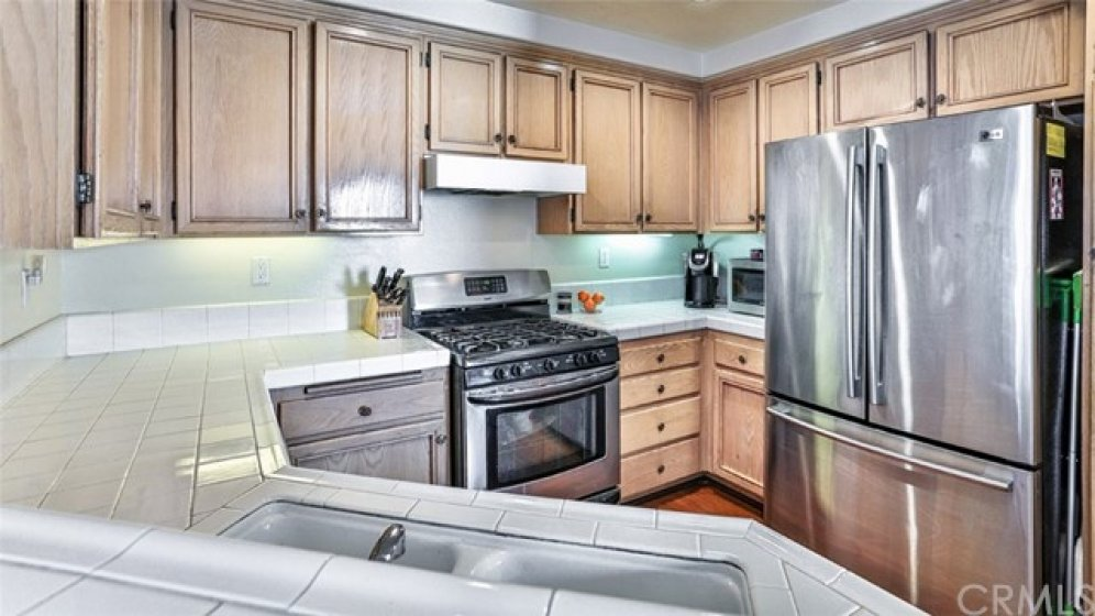 Stainless steel appliances, fridge included.