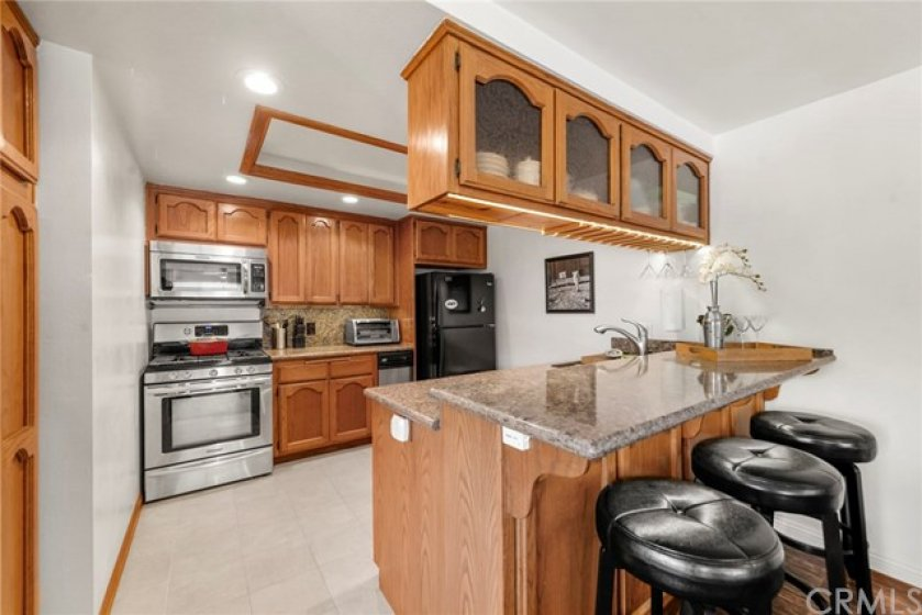 Notice the open kitchen with breakfast bar and plenty of cabinet space!