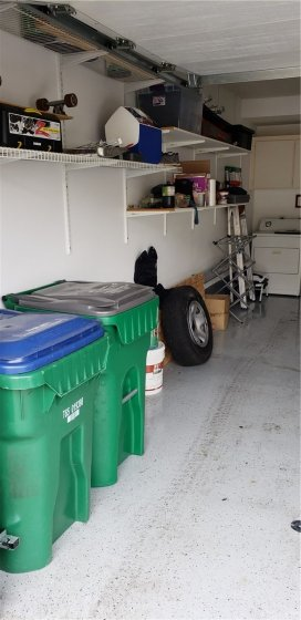 Finished garage with epoxy floor and storage racks