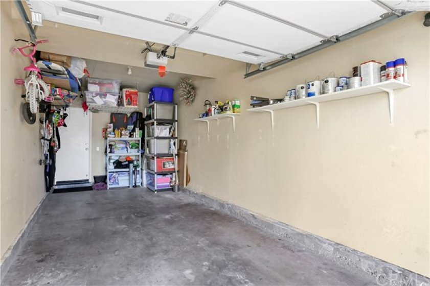 Extra long garage with overhead storage. Tankless water heater in the back corner.