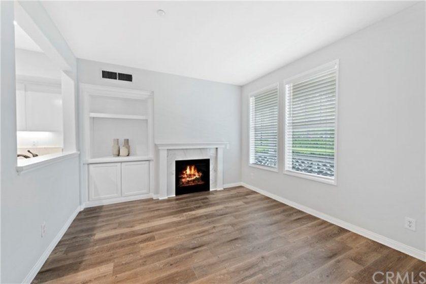 All fresh paint, cordless blinds and upgraded marble surround on gas fireplace. New high end and durable laminate flooring. Custom wood buffet makes this open concept the perfect backdrop for entertaining.