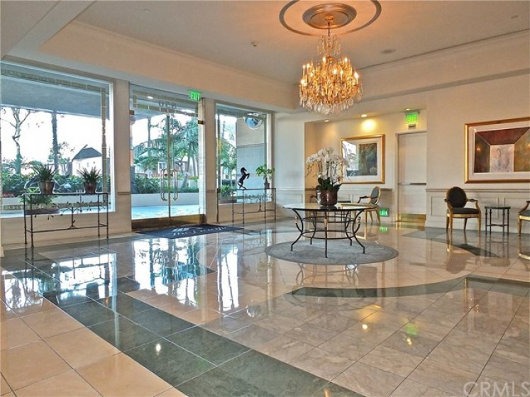 See the beautiful lobby as you enter into The Pacific with 24 hour concierge service.