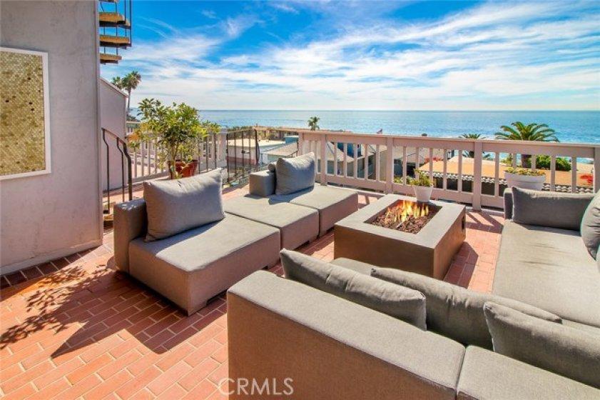 Mesmerizing ocean views define this gorgeous soft contemporary-style coastal retreat.