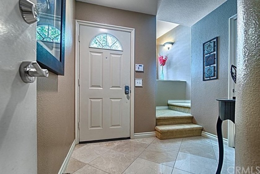 Entry way has beautiful Marble Flooring and Sculptured Carpeting