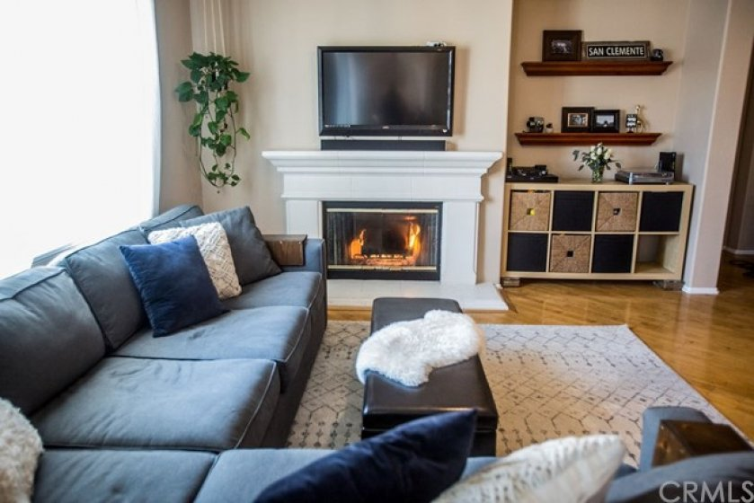 A close up view of the cozy fireplace and media niche.