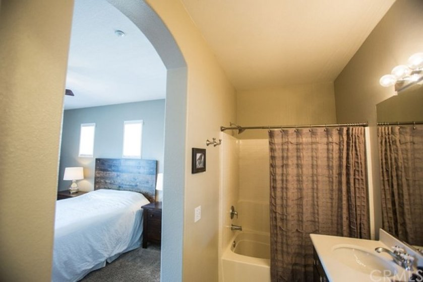 The master bath features a tub/shower combination with tiled shower wall.