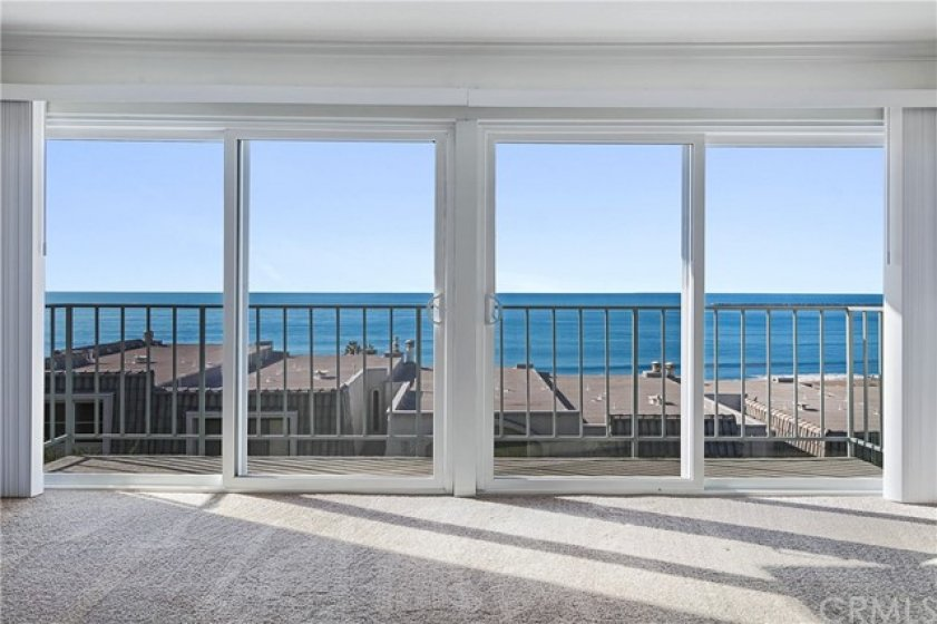 The master suite has panoramic ocean views and a balcony