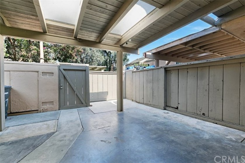 Private covered patio with skylights and enclosed storage area.  Door leads directly to 1 of 2 assigned carports