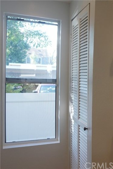 Window to front patio. Indside laundry
