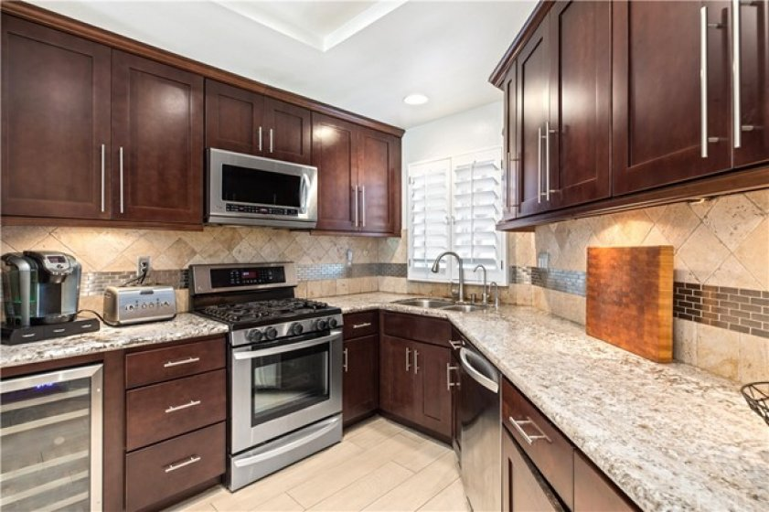 Newer cabinets that go up to the ceiling, newer granite counter tops, all new stainless steel appliances. Beautiful stone back splash with decorative details.