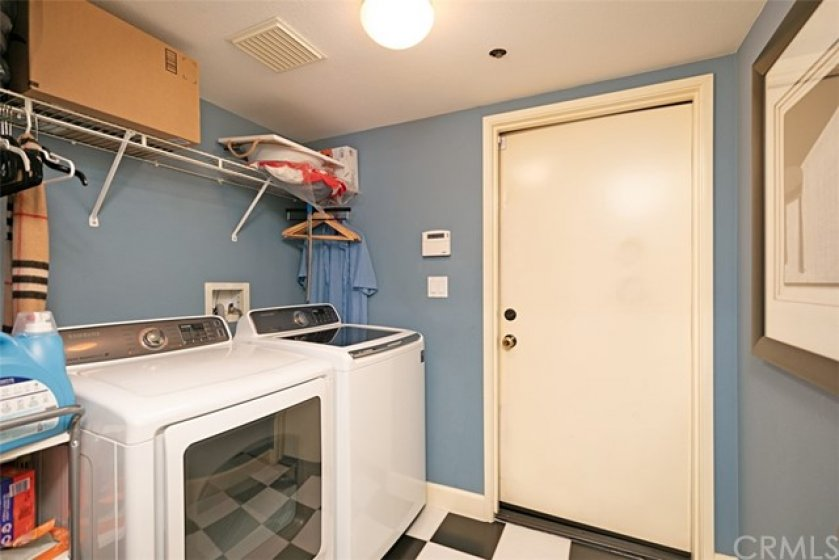 Laundry room with direct access to two car garage.