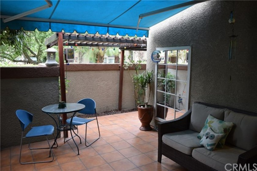 Tiled patio with awning (can be pulled back to allow more sun in)