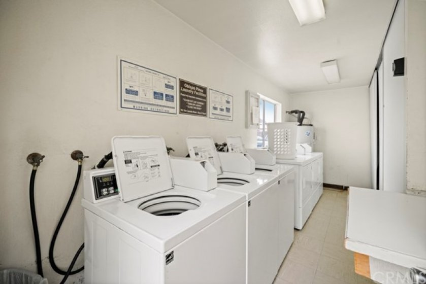 Community laundry room just steps from the home