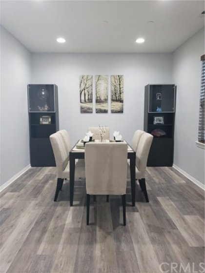 Besides the eat-up bar in the kitchen, you also have a formal dining room for a huge table at the holidays (or everyday if you're lucky) with the LVP flooring, light and bright windows with coverings.