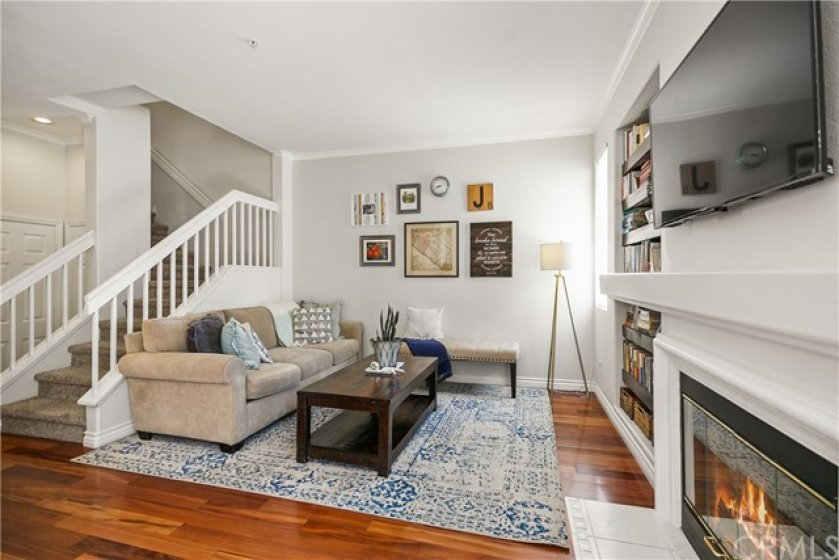 Crown molding and cozy fireplace greets you!