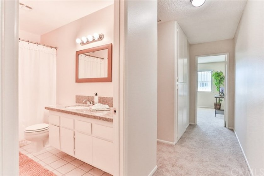 Full bathroom upstairs has upgraded countertops and a shower in tub.