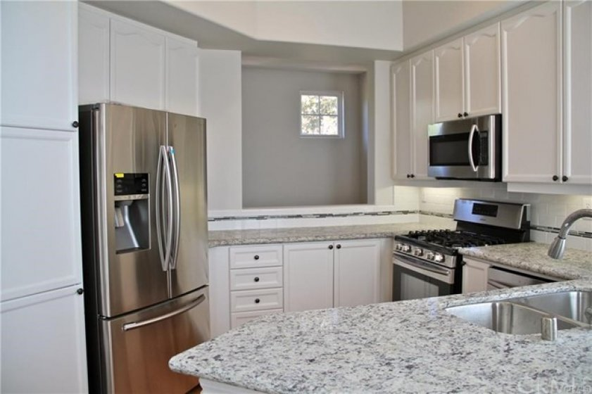Kitchen is open to the hall and dining room - Fridge is included