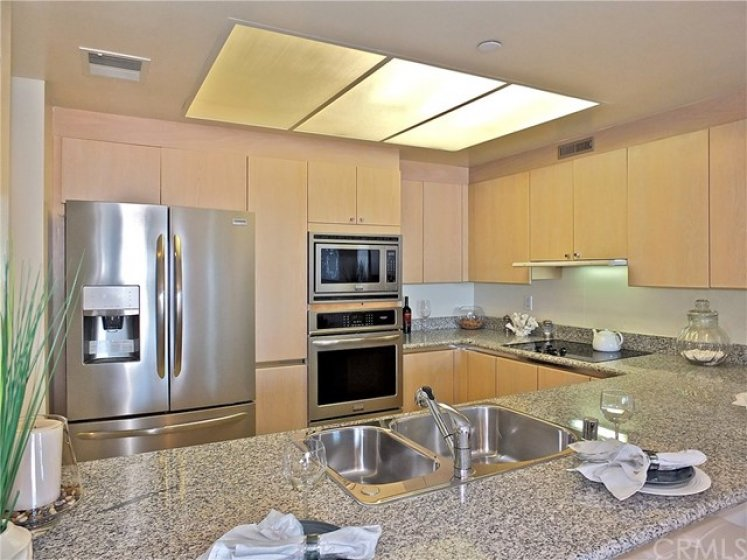 Fabulous kitchen with wonderful and spacious granite countertops, stainless steel built-in appliances,  2 large lazy-susans cabinets and lots more amazing storage space.