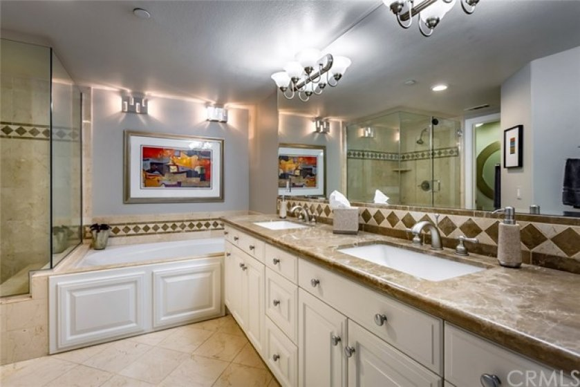 Master Bathroom with Jacuzzi Tub, Double Sinks with Marble Counter Top, Designer Fixtures and Separate Shower