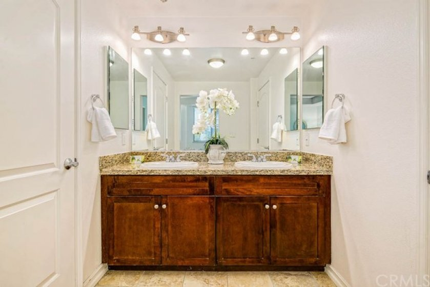 Double sinks, granite countertops, double medicine cabinets, and plenty of under sink cabinet storage.