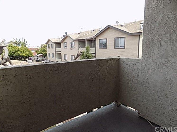 Deck/balcony area overlooking neighborhood.  Deck is off of dining area.