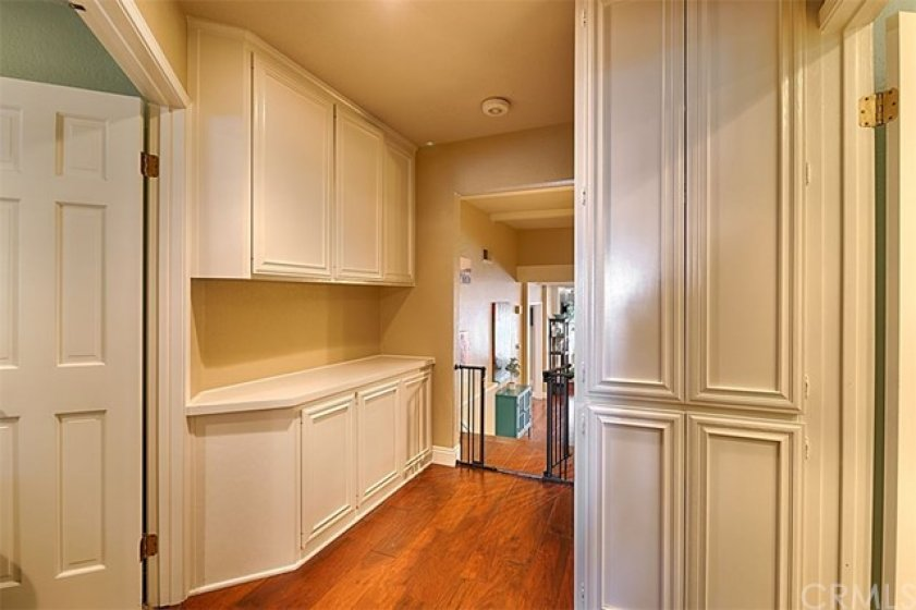 Upstairs hallway, linen cabinet along with storage built-ins.