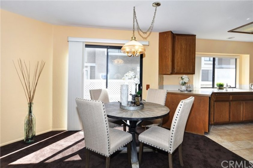 Dining room with balcony is adjacent to kitchen