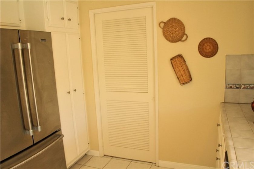 POCKET DOORS SEPARATING THE LAUNDRY ROOM FROM THE KITCHEN
