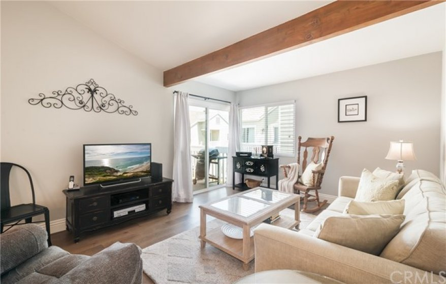 OPEN CONCEPT LIVING ROOM with VAULTED CEILINGS and BEAM
