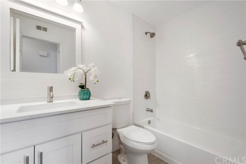 Newly remodeled bathroom with new cabinet, toilet and tile